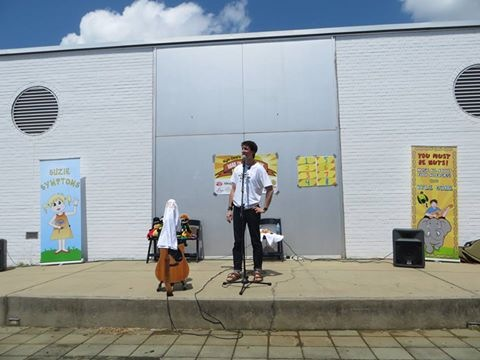 My one outdoor show at the Children's Museum in Richmond. So hot that I had to cover up my guitar and mixing board!