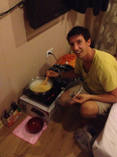 Cooking away on our hot plate in our hotel room.