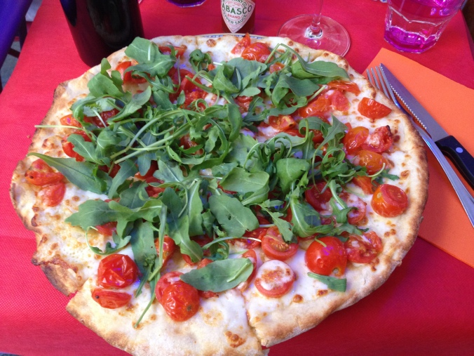 My pizza of choice with tomatoes and arugula.